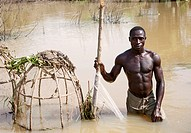 Portrait Of fisherman Fishing In River Niger.