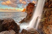 Northwest coast of Majorca. Sa Costera intermitent fresh water spring waterfall. Long exposure. Balearic islands, Spain.