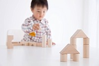 Boy playing with wooden building block