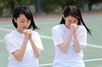 High School Girls Praying for Win