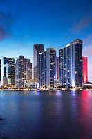 USA, Florida, Miami, city skyline from Brickell Key, evening.
