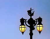Elaborate street-lamp in the royal quarter in the heart of London, England, at dusk.