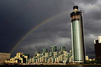 Rainbow over Vauxhall Tower and St George Wharf Building - London, England.