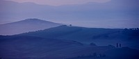 Tuscan landscape of hill slopes in Val D'Orcia, Tuscany, Italy