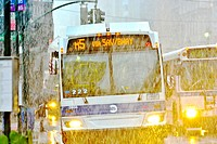 Morning rush hour traffic, Mass Transit, MTA Public Transportation Buses, Metropolitan Transportation Authority, winter storm, raining and snowing, Mi...