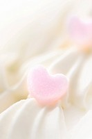 Close up of cream decorations, white background, soft focus