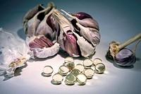 Garlic oil capsules, vitamin D pills.
