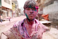 India, Uttar Pradesh, Vrindavan, portrait of a male teenager, Holi, spring festival, festival of colours, teenager with colour powder, portrait
