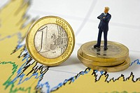 euro coin and financial business chart