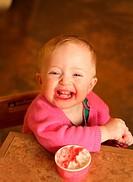 Baby girl eating Gelato at Gelateria