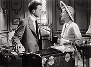Joan Fontaine and Robert Arthur in 'September Affair'. British-born American actress Joan Fontaine and American actor Robert Arthur acting in 'Septemb...