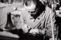 A gilder working. Italian gilder Luigi Dossi decorating with pure gold an eighteenth-century frame inside the Giorgio Marconi's workshop in via Tadino...