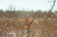 Teenage boy hunting with shotgun in Petersburg State Game Area, Michigan, USA