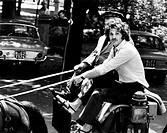 Tony Musante on a cart. The American actor Tony Musante (Anthony Peter Musante) travelling on a cart. Rome, 1970s