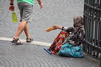 woman begging outside church in rome italy