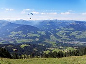 Austria, Tyrol, Kitzbuehel Alps, View from Hohe Salve to Brixen Valley with Hopfgarten, paraglider
