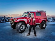 Man in front of a modified Jeep, Iceland.