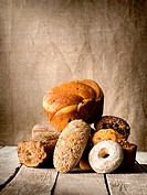 Bread assortment on background of the old canvas.