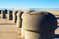 Concrete guard posts along the Pacific Beach Boardwalk. San Diego, California, United States.