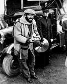 Bud Spencer and Giuliano Gemma on the set of the film Even Angels Eat Beans. Italian actor Bud Spencer (Carlo Pedersoli) leaning on a car wing beside ...