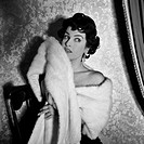 Silvana Pampanini wearing a fur shawl. Italian actress Silvana Pampanini wearing an elegant fur shawl. 1950s