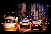 Traffic at street, taxis, night. Barcelona, Catalonia, Spain.