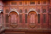 Intricately carved walls allow women in purdah to look out, Mehrangarh Fort, Jodhpur, Rajasthan, India.