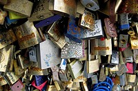 Europe, France, Paris. Love-locks on the Pont de l'Archeveche over the Seine.