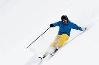 Mid adult man skiing downhill, Obergurgl, Austria