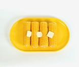Corncobs with Pieces of Butter