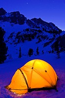 Yellow dome tent at night in winter, Inyo National Forest, Sierra Nevada Mountains, California.