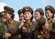 Smiling North Korean Female Soldiers In Tower Of The Juche Idea, Pyongyang, North Korea.
