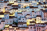 The White Town of Casares clings to a steep hillside. At dawn. Málaga province, Andalusia, Spain.