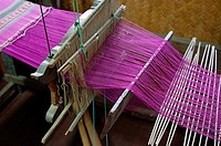 A weaver´s loom displayed at the Sergeant Major Thawee folk museum, Phitsanulok, Thailand.