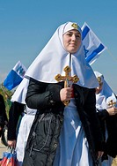 Nuns on the way to participating in a baptising ritual the epiphany in the baptismal site Qasr al yahud (Israel)