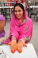 India: Punjab: Young Woman with her hands painted with henna