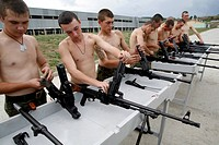 Soldiers cleaning rifles at a Russian military base in South Ossetia's capital Tskhinvali.