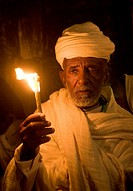 Ethiopian Orthodox worshiper hold candeles during the Holy fire ceremony at the Ethiopian section of the Holy Sepulcher in Jerusalm Israel
