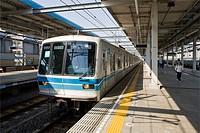 Train arrives at station near Tokyo Japan.