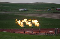 Watford City, North Dakota - Natural gas is flared off as oil is pumped in the Bakken shale formation. The gas is burned because no pipelines have bee...