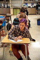 A San Clemente, CA, high school chemistry class answers quiz questions. Note purple hair dye.