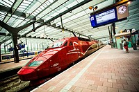 Red Thalys TGV stopped at Rotterdam Centraal Station, Holland.