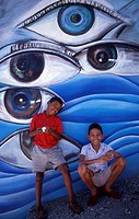 two cuban boys standing in front of wall painting, Cuba, Santiago de Cuba