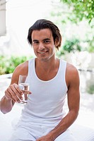 Man drinking water on patio