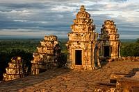 Phnom Bakheng Temple. Sunrise. Phnom Bakheng is located 1,30 meters (4,265 feet) north of Angkor Wat and 400 meters (1,312 feet) south of Angkor Thom.