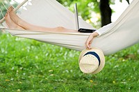 Young woman relaxing on hammock, Debica, Poland.