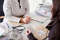 Doctor prescribes medication to patient.