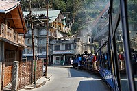 """English Steam Train enthusiasts taking photos on the train as monks look on. The Darjeeling Himalayan Railway, also known as the """"""""Toy Train"""""""", is a 2..."""