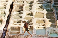Worker at the Chouwara Tannery, Fez or Fes, Morocco, North Africa.