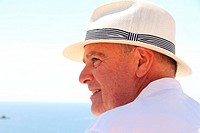 Portrait of a handsome man in withe with hat Spain.